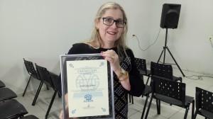 Maria auxiliadora recebeu placa de honra ao mérito em homenagem ao marido